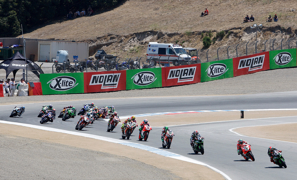 . A group of riders exit turn-2 at the FIM Superbike World Championship at Mazda Raceway Laguna Seca on Saturday, July 8, 2017.  (Vern Fisher - Monterey Herald)