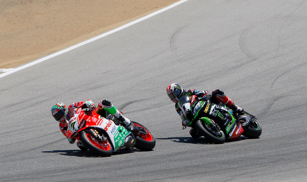 . Chaz Davies (7) from Great Britain leads Jonathan Rea (1) from Great Britain into turn-3 at the FIM Superbike World Championship at Mazda Raceway Laguna Seca on Saturday, July 8, 2017.  Davies would finish first and Rea second.  (Vern Fisher - Monterey Herald)
