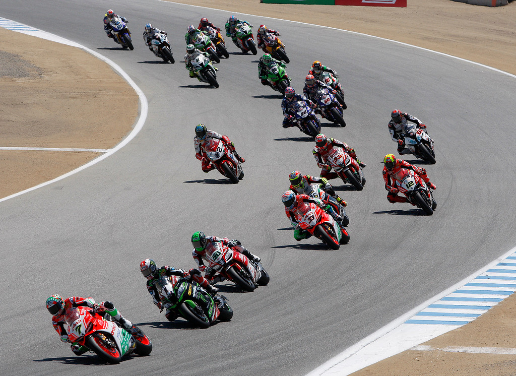 . Chaz Davies (7) from Great Britain leads a group of riders into turn-3 at the FIM Superbike World Championship at Mazda Raceway Laguna Seca on Saturday, July 8, 2017.  Davies would go on to win the race.  (Vern Fisher - Monterey Herald)