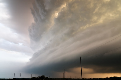 A beautiful supercell with impressive structure dives southeast across the Arbuckle Mountains in south-central Oklahoma on April 10, 2007.