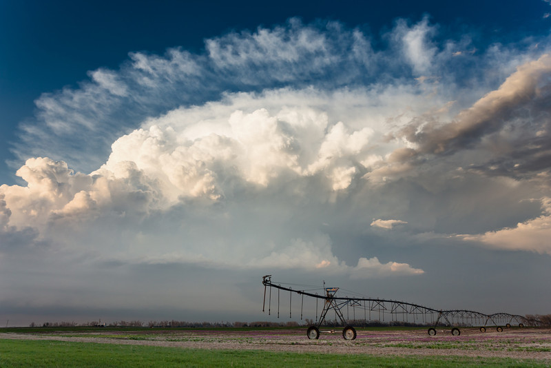 An intense supercell is illuminated by the setting sun near Great Bend, KS, on April 7, 2013.