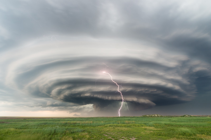 "Lightning strikes beneath a striated supercell with ""stacked plates"" appearance near Winona, KS, on June 8, 2019."