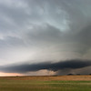 An incredibly beautiful, yet ominous, supercell traverses the Quartz Mountains near Roosevelt, OK, on June 16, 2008.