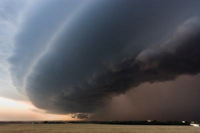 A frightening shelf cloud ushers an intense HP supercell into the city of Clinton, OK, on May 19, 2012.