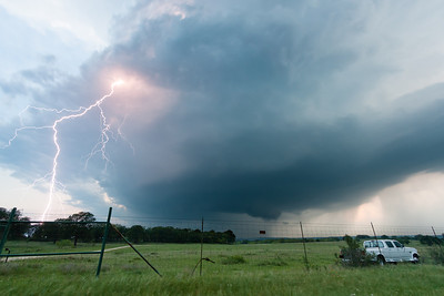 A spectacular cloud-to-ground lightning bolt emanates from a supercell north of Stephenville, TX, on May 5, 2009.