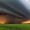 Beautiful supercell structure takes on orange hues from the setting sun near Petersburg, NE, on June 16, 2014.
