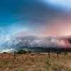 The setting sun bathes an HP supercell with a spectacular array of colors northeast of Seymour, TX, on June 16, 2008.