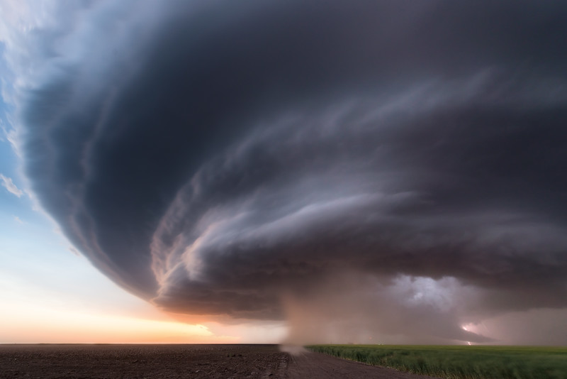 An intense supercell thunderstorm bears down on the high plains near Winona, KS, at dusk on June 8, 2019.