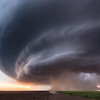 An intense supercell thunderstorm bears down on the high plains near Winona, KS, at dusk on June 8, 2019.