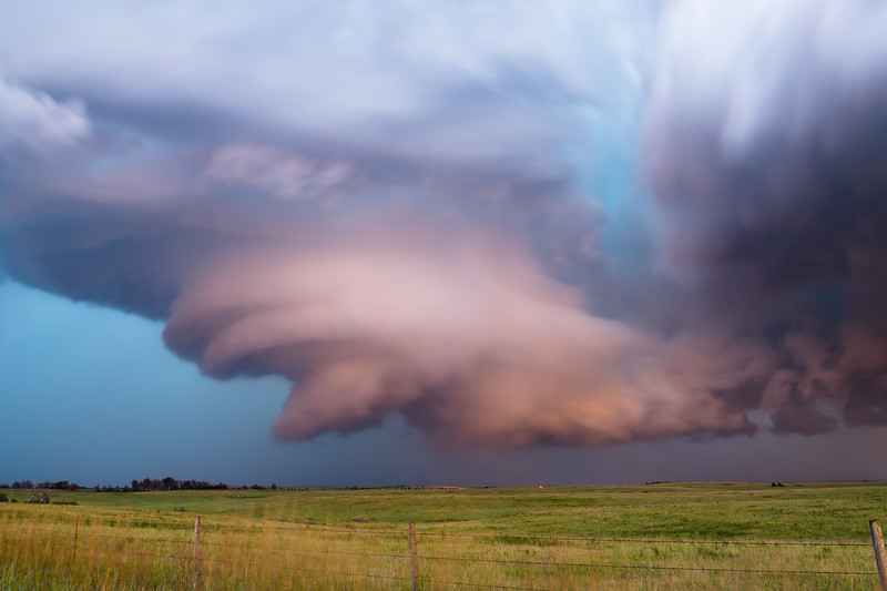 A supercell near Cedar Vale, KS, shows off an impressive low-level mesocyclone at dusk on September 1, 2014.