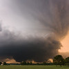 An imposing supercell bears down on Ada, OK, producing a cone tornado just west of town. Shot just before sunset on May 21, 2011.