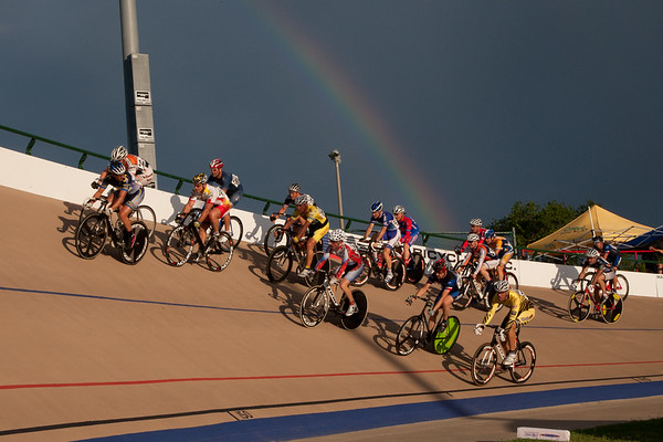 The rains left and the sun arrived, displaying a rainbow over the filed of the Mens 44-49 Points Race.