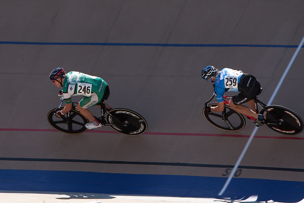 Mark Rodamaker leads Frederick Hofman through the shade of the press box during an early sprint round.