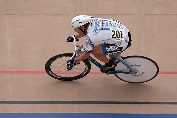 Darrell McPherren holds his line coming out of turn two as he starts his flying 200m TT.
