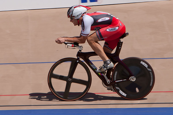 Dave Gray powers down the back strait during his 3km TT.
