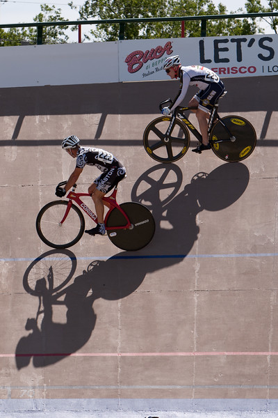 John Simmons is shadowed by Michael McCue during an early sprint round.