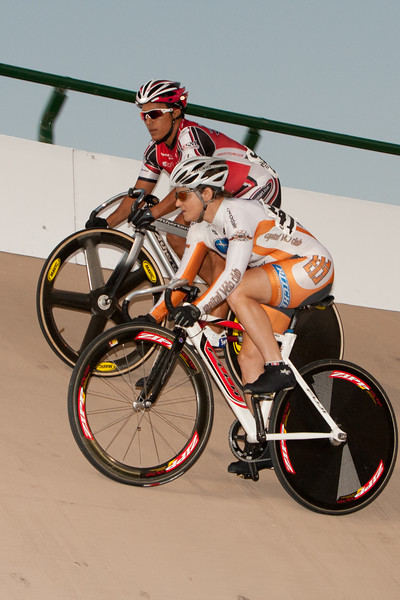 Suzanne Goodwin is kept near the rail by Kimberly Edwards during one of their sprint matchups.