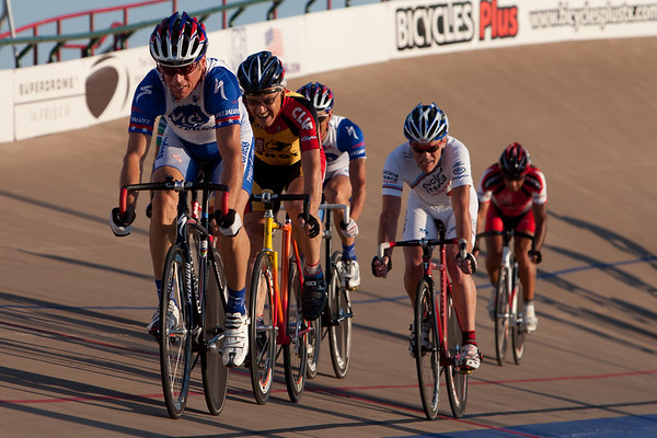 The field chases down a break during the 55-59 and 60-64 combined field points race.