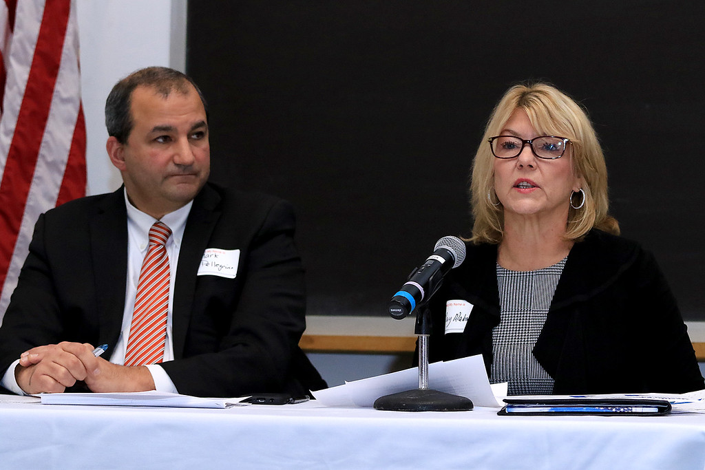. Local School Districts came together on Tuesday night at Fitchburg State University to discuss state funding and what�s needed in the region. there where other such meetings happening around the state. Gardner\'s School Superintendent Mark Pelligrino listens a Ayer Shirley Regional School District Superintendent Mary Malone address her districts issues during the presentation. SENTINEL & ENTERPRISE/JOHN LOVE