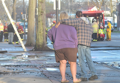 Lisa Yanick-Jonaitis - Morning Sun  Superior Street Barber Shop owner Miguel Ortiz and his co-worker Jane Clarke watch efforts to control a fire that destroyed his building on Tuesday, April 25, 2017.