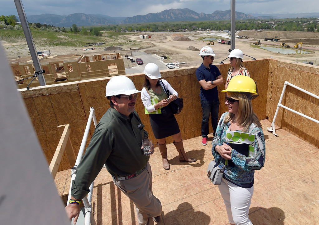 . Mary Ellen Wood, at right, and Chris Ratay, both of RE/MAX Alliance, talk about the newly built homes during a site tour of the Superior Town Center on Thursday in Superior. For more photos of the construction go to www.dailycamera.com Jeremy Papasso/ Staff Photographer/ June 1, 2017