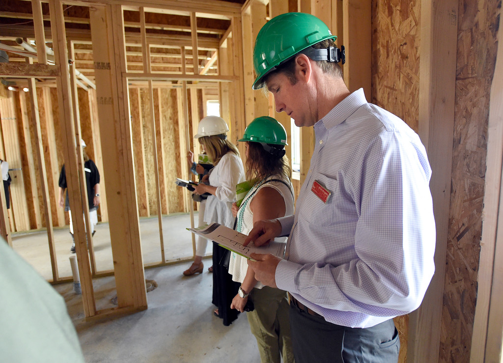 . Brian Margolis looks at the layout of a home on a piece of paper during a site tour of the Superior Town Center on Thursday in Superior. For more photos of the construction go to www.dailycamera.com Jeremy Papasso/ Staff Photographer/ June 1, 2017