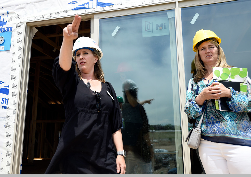 . Mary Ellen Wood, with RE/MAX Alliance, at right, listens as Alicia O\'Herron, with Wonderland Homes, explains a newly built home during a site tour of the Superior Town Center on Thursday in Superior. For more photos of the construction go to www.dailycamera.com Jeremy Papasso/ Staff Photographer/ June 1, 2017