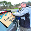KRISTOPHER RADDER — BRATTLEBORO REFORMER<br /> Al puts up a sign on his vehicle before the caravan travels to Brattleboro, Vt., to show solidarity with essential workers and lift up calls for crisis responses that focus on workers' health and welfare during International Workers Day on May 1, 2020.
