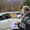 KRISTOPHER RADDER — BRATTLEBORO REFORMER<br /> Ellen Schwartz, of Vermont Workers Center, uses a microphone to talk to people before traveling to Brattleboro, Vt., to show solidarity with essential workers and lift up calls for crisis responses that focus on workers' health and welfare during International Workers Day on May 1, 2020.