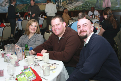Mr. Pepper Ailor, director of programs at Freedom Alliance, poses for a photo with dinner guests at the Freedom Alliance's military appreciation dinner on Feb. 12 at Charley's Other Brother restaurant in Mt. Holly, N.J. The Freedom Alliance, an educational and charitable organization that sponsors numerous program activities aimed at supporting and honoring U.S. military service members and their families, hosted the dinner as a way to show their support to 108th Wing Airmen that have deployed in the past year in support of operations Enduring Freedom and Iraqi Freedom. (U.S. Air Force photo by Staff Sgt. Armando Vasquez, 108th WG / PAO)