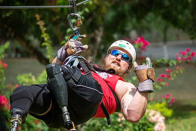 Marine Corporal Larry Draughn, who lost both legs to an IED blast, enjoys the final length of the zip lines at Vista Los Sueños.