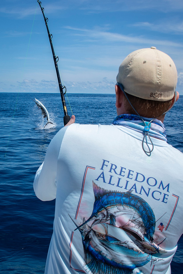 Marine veteran Brandon catches his first sailfish.