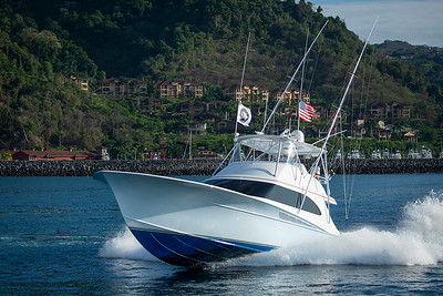 "The troops were treated to two-days of fishing on sportfishing yachts like this one, ""Pelese"", flying Old Glory and a Freedom Alliance flag."