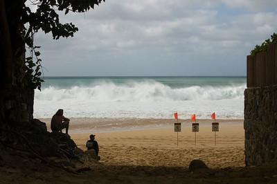 People gathered to watch the surf contest  Ehukai BeachPipeline Surf Contest   North Shore, O'ahu, Hawai'i 061207.151455