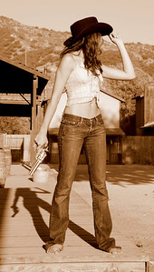Pretty Cowgirl Model in Blue Jeans with a Gold 45 Revolver!