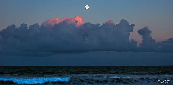 Moon Rise and Sunset Over An Angry Sea