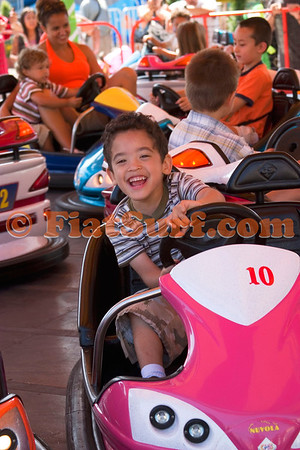 This little guy was having a blast on the bumper cars.  The crowd of adults watching almost melted when he smiled.