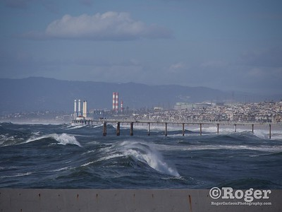 Storm surf at Hermosa pier and Manhattan pier