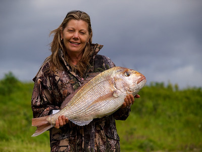 Jacqui Logan poses with her winning snapper of 6.64kg