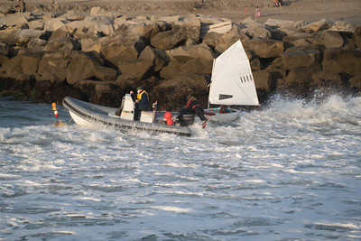 Santa Cruz harbor surfers save young sailors capsized in front of jetty rocks during huge swells of NW waves 17 foot at 18 seconds. Heros
