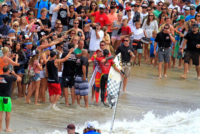 Carissa_Moore_Courtney_Conlogue_US Open_Wms Final_7-28-13_4196.JPG<br /> <br /> Courtney Conlogue gives Carissa Moore a huge congratulatory hug after a close finish in the Vans US Open of Surfing Women's Final.