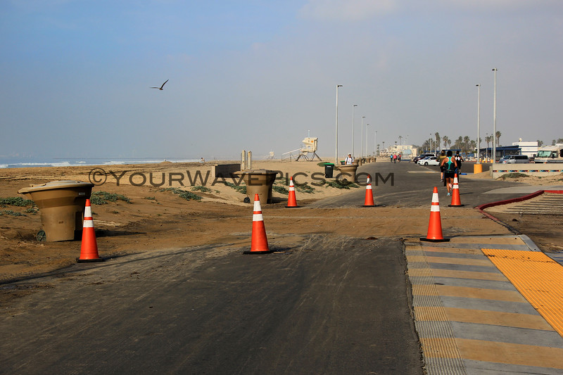 2018-12-18_Bolsa Chica_Bike Path Flood_1.JPG<br /> <br /> A big WNW swell hit North Orange County Tuesday.  The morning high tide swept over the bike path and into the parking lot in some areas at Bolsa Chica State Beach.
