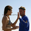 Former surf coach, Brad Woodbury, gives Irene Jeffries a high five for her 1st place finish in Women's Longboard!