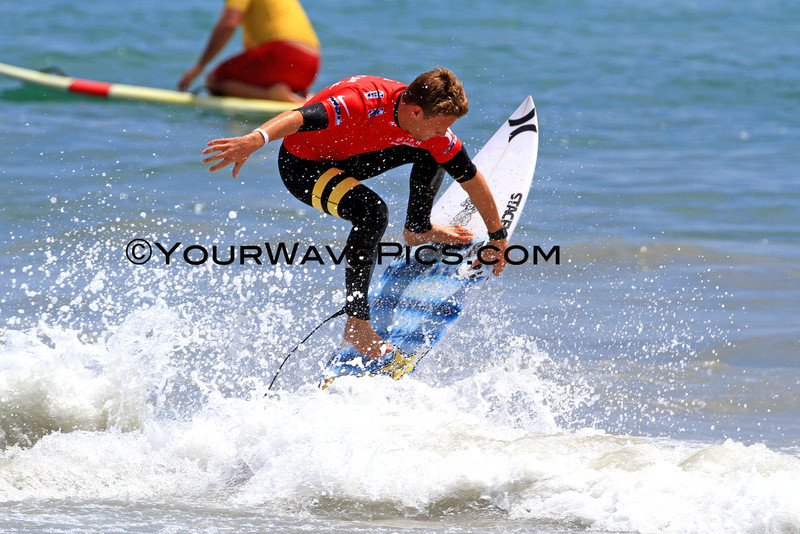 US Open of Surfing 2012, Day 4 - Mens Round of 48 - Mitch Crews enters the water with flair