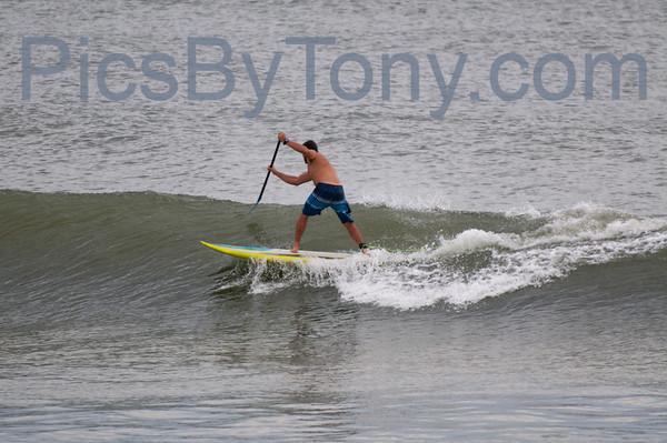 Folks Paddle Boarding Surfing at Northside of Pier in  Flagler Beach, FL on 09/22/2013