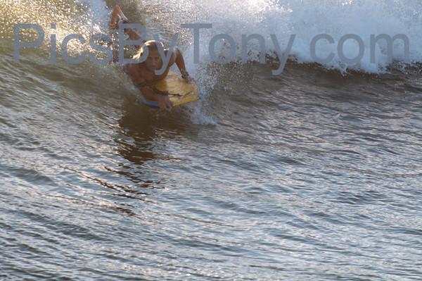 Folks Surfing at Southside of Pier in  Flagler Beach, FL on 09/21/2013