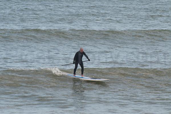 Folks Surfing at Pier in  Flagler Beach, FL on 01/15/2013