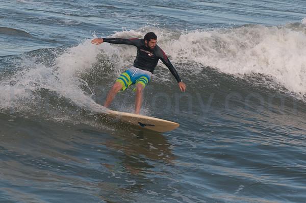 Folks Surfing at Pier in  Flagler Beach, FL on 04/09-4/18/2013