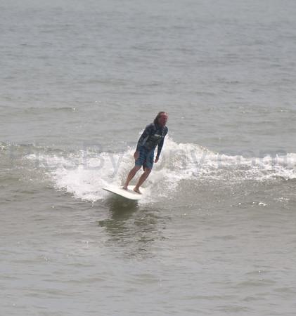 Folks Surfing at Pier in  Flagler Beach, FL on 04/30/2013