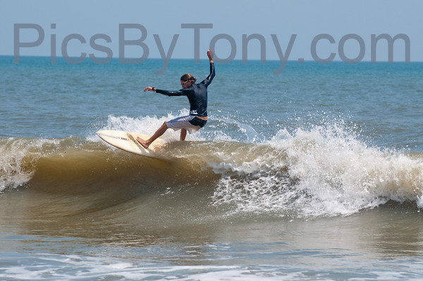 Folks Surfing at Pier in  Flagler Beach, FL on 08/12/2013